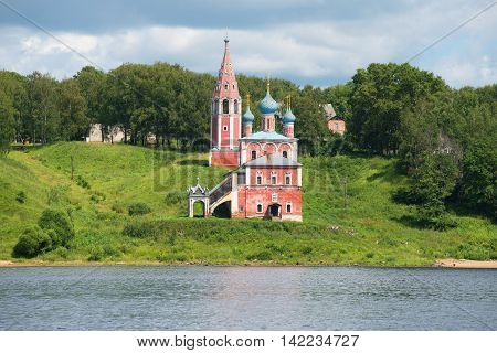 The view of the old Church of our lady mother of Kazan on the left Bank of the Volga river on a summer day. The town of Tutayev Yaroslavl region. Russia