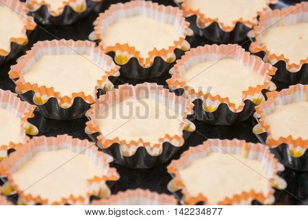 Preparations for baking cakes in molds on a baking sheet