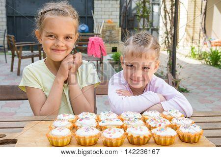 Two Girls Rejoice Freshly Baked Easter Cupcakes