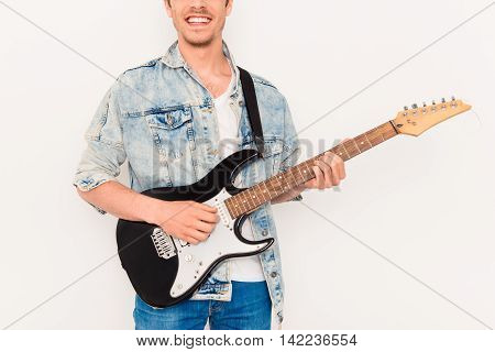 Close Up Of Young Rocker With Beaming Smile And Electric Guitar