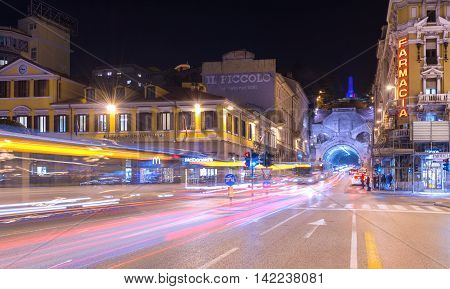 Trieste, Italy - December of 2015: Night view of the city with car light trails on Carlo Goldoni Square