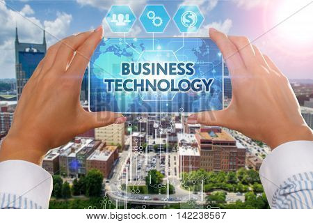 Business, Technology, Internet And Network Concept. The Girl Looks At A Virtual Screen Smartphone.