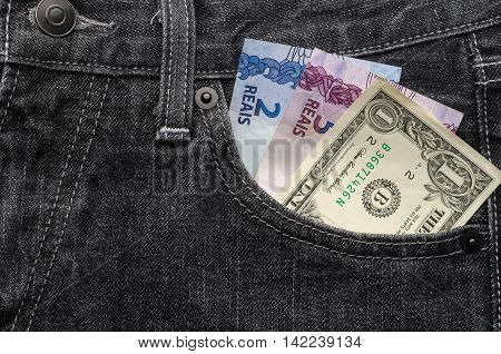 One Dollar And Brazilian Money Inside Jeans Pocket