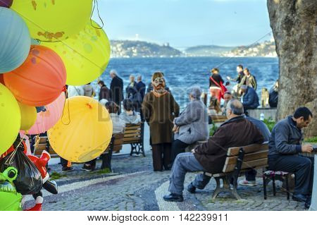 Istanbul Turkey - March 10 2013: View of the Bosphorus in Istanbul. people are resting in Beylerbeyi pier. View of the European and Asia side of Istanbul from the Bosphorus.