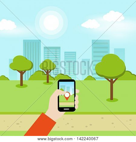 A person using a smartphone to play an online geolocation game in the park.