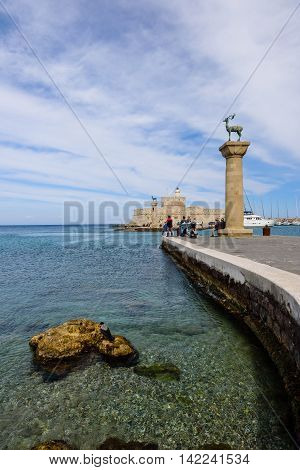 Rhodes island, Dodecanese, Greece - May 20, 2016: The entrance to the harbor in Rhodes town.
