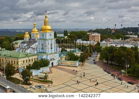 Kyiv, Ukraine - September 7, 2013: View of St. Mikhail's minster chapel. Medieval priory with park trees