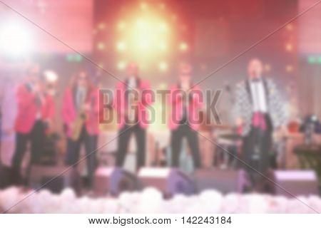 Blur image of Musician Live show on stage at night, Vintage colour tone