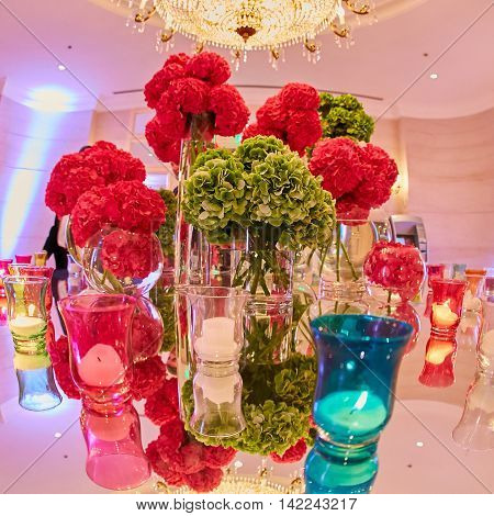 Wedding setup. Red and green flowers. Shallow dof