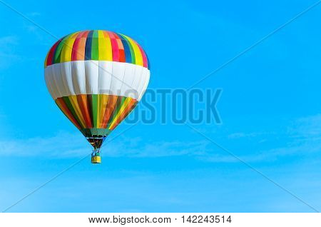 Hot air balloon with blue sky and text space