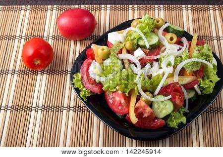 Small Portion Of Vegetable Salad Of Tomato, Cucumber, Olives