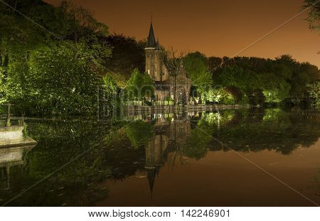 Nocturnal view of Minnewaterpark also known as the lovers lake in Bruges (Belgium)