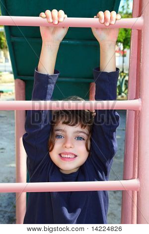 Little Girl Climbing Pink Stairs Of Slide