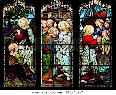 EDINBURGH, SCOTLAND - OCTOBER 02, 2013: Stained glass window illustrated Bible stories in the St Giles' Cathedral of Edinburgh Scotland UK.