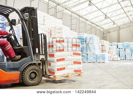 forklift loader working in warehouse