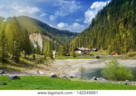 Beautiful View Of Alpine Lake, Gosausee. Traditional Austrian Houses In Alps Mountains.