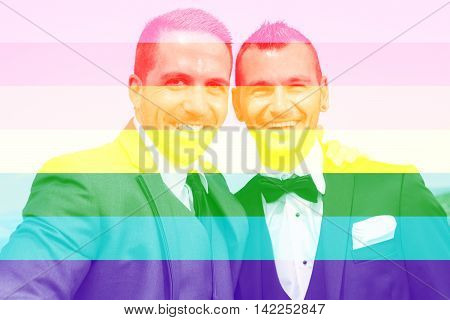 A Portrait of a loving gay male couple on their wedding day with sky on the back.