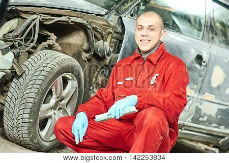 auto mechanic at car body repair work