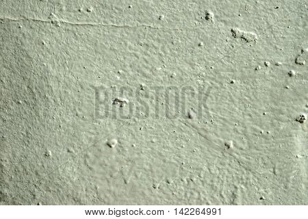 Gray painted wall in divorces and smudges.