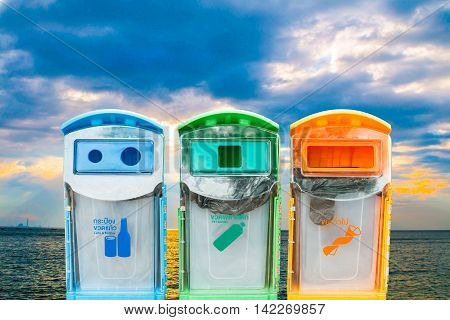 Recycling bins on a blurred background with sky background beach ecology.
