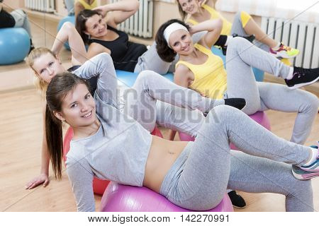 Sport Concepts. Group of Five Laughing Smiling Caucasian Females Having Muscles Stretching Exercises in Class.Horizontal Image