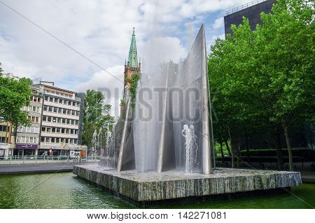Fountain In German Reunification Memorial Square And Protestant Church Saint Johns (johanneskirche)