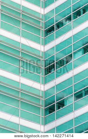 Green and white modern office building detail