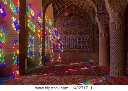 SHIRAZ IRAN - May 3 2016: Nasir al Molk or Pink Mosque in Shiraz Iran. The stained glass windows produce a colourful effect on the carpets columns and walls in the morning.