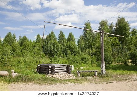 Water well on the background of forest. Russian remote