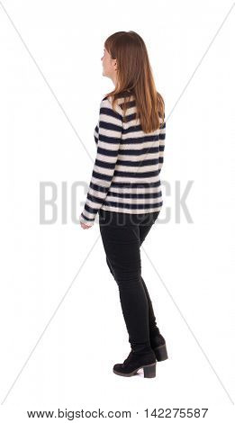 back view of walking  woman. beautiful blonde girl in motion.  backside view of person.  Rear view people collection. Isolated over white background. Girl in a striped jacket leaves left.