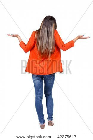 Back view of angry young woman Rear view. isolated over white. backside view of person.  Rear view people collection. Isolated over white background. girl in a red jacket, her arms up in surprise.