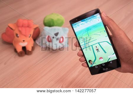 CHIANG MAITHAILAND - JULY 202016 :An Android user reads the warning screen for the new Pokemon Go app. that was released on July 6 2016. It is reality mobile game for smart phones by Niantic