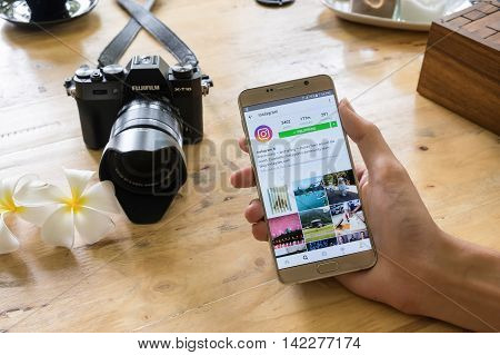 CHIANG MAI THAILAND - JULY 242016: A man holds Samsung note 5 with mew logo of Instagram application on the screen. Instagram is a photo-sharing app for smartphones.