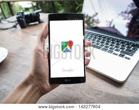CHIANG MAI, THAILAND - MAY 2, 2016: A man hand holding screen shot of google maps app showing on LG G4. Google Maps is most popular mapping service for mobile