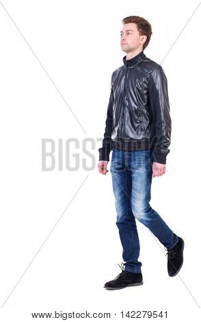 Back view of going  handsome man. walking young guy . Rear view people collection.  backside view of person.  Isolated over white background. Curly guy in a black leather jacket is proudly raising his