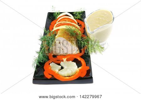 tuna fillet on black ceramic plate with cream sauce