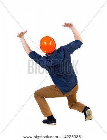 back view business man protective construction helmet protects hands from what is falling from above. Rear view people collection.  backside view of person.  Isolated over white background. a man