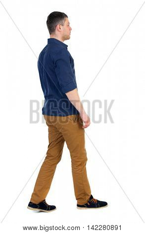 Back view of going  handsome man. walking young guy . Rear view people collection.  backside view of person.  Isolated over white background. a man in a blue shirt with the sleeves rolled out to the