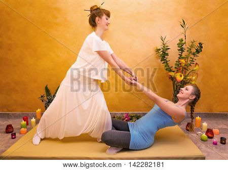 Women practicing physical exercise in relaxation atmosphere