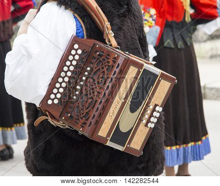 CAGLIARI, ITALY - May 1, 2013: 357 ^ Religious Procession of Sant'Efisio - Sardinia - detail of an accordion with keyboard buttons