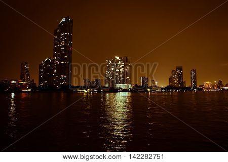 Bangkok's Chao Phraya river at night .
