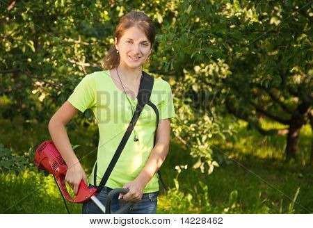 Girl Works With  Grass-cutter