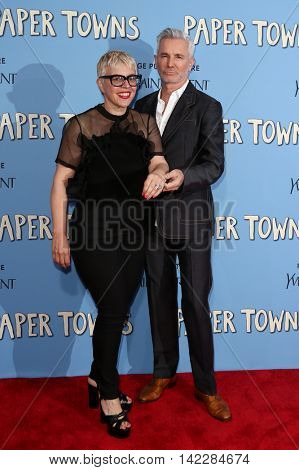 NEW YORK-JUL 21: Catherine Martin (L) and Baz Luhrmann attend the