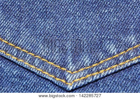 Denim jeans texture with pocket seams for fashion background