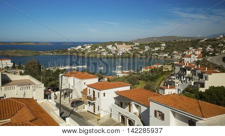 View of the Marina and a small town on the Andros island, Greece.