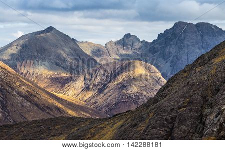 The Scottish Highlands. Detailed photo of the Cuillin mountains on a cloudy day - Isle of Skye, Scotland, UK