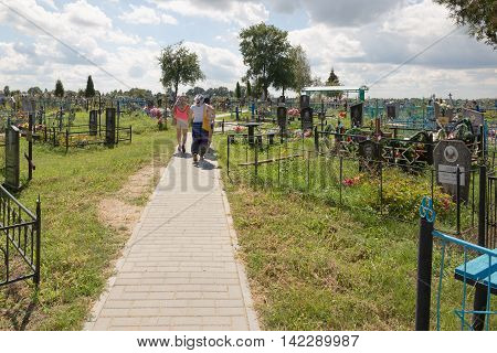 Turov, Belarus - August 7, 2016: Place Of Worship Pilgrims Growing Stone Cross In A Cemetery In The