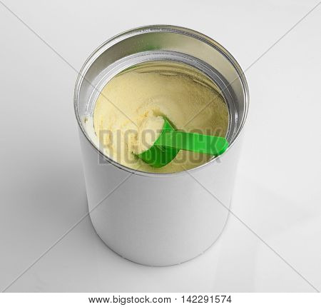 Baby milk formula in can on white background