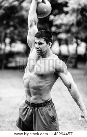 Crossfit Athlete Lifting Kettle Bell