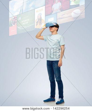3d technology, virtual reality, entertainment, cyberspace and people concept - happy young man with virtual reality headset or 3d glasses looking at screen with internet news